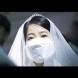 Любов и зараза: 3000 булки с маски се врекоха едновременно на любимите си на грандиозна масова церемония (Снимки)