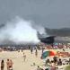 Руски военен кораб се вряза в плаж с хора-Видео
