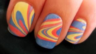 Мраморен маникюр с бледо синьо, жълто и оранжево