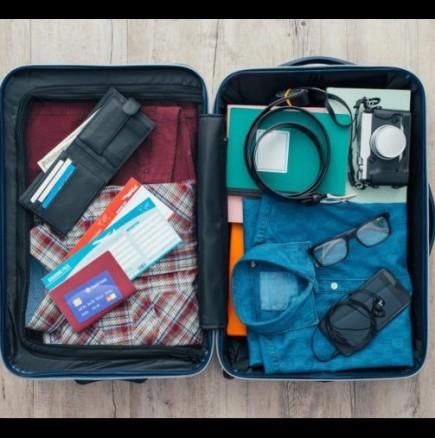 Как се събира много багаж в малък куфар