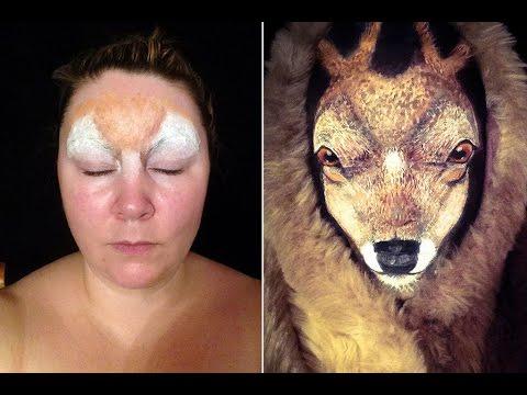 Жена маскирана като елен и ягуар